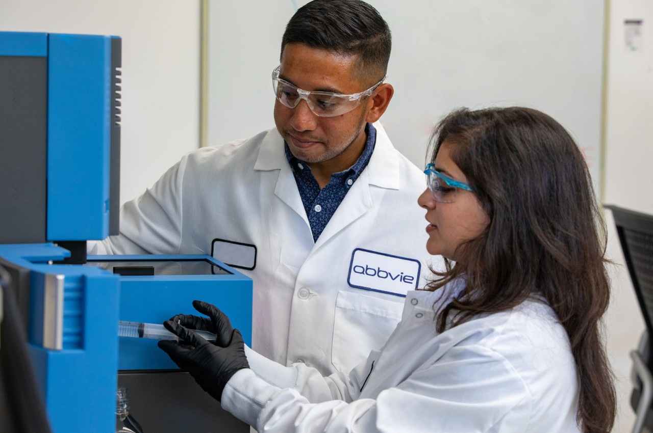 Male and female AbbVie scientists working in a lab