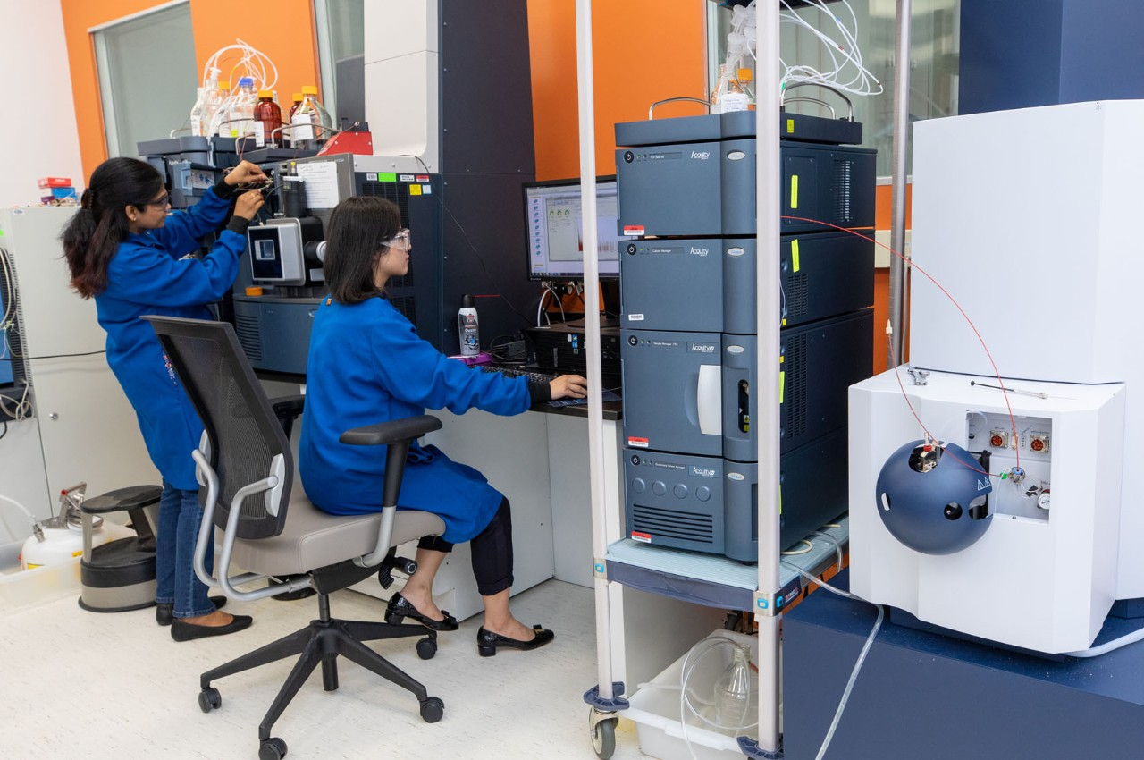 Two women working at a computer in a lab