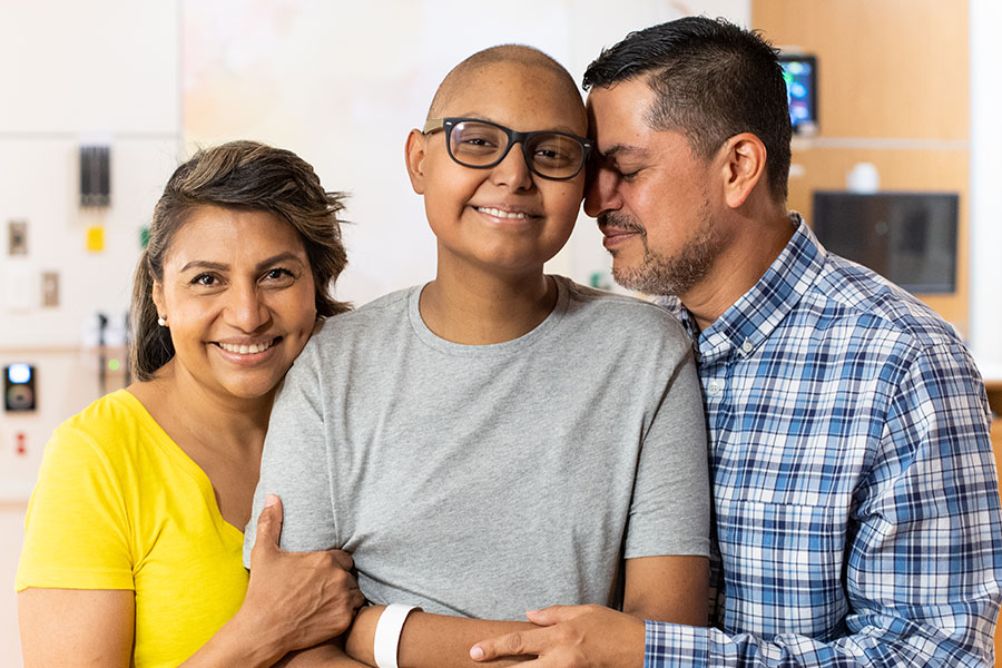 A family of a patient smiling at St. Jude.