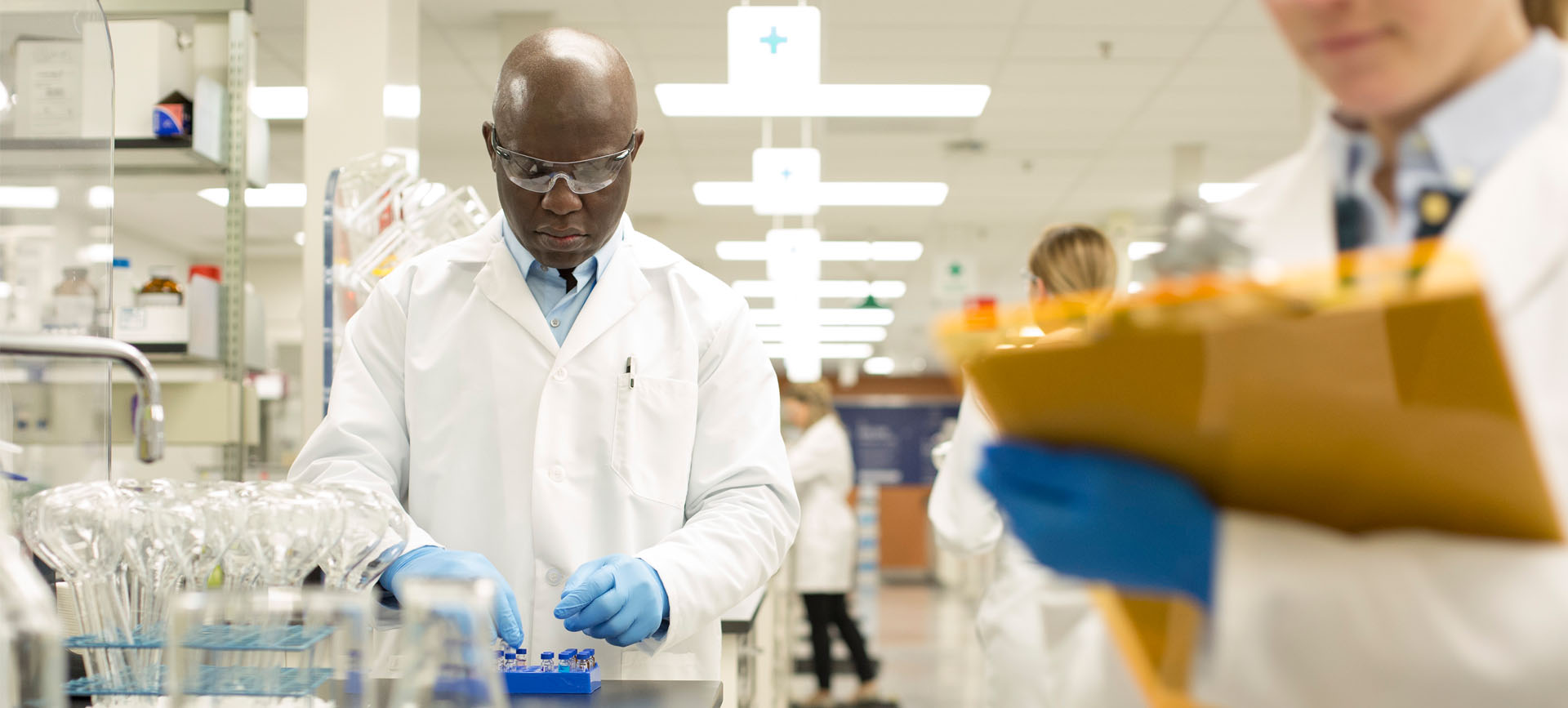 Black doctor in lab coat working on blood cancer pharmaceuticals
