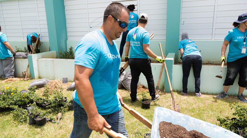 AbbVie team doing yardwork in Puerto Rico.
