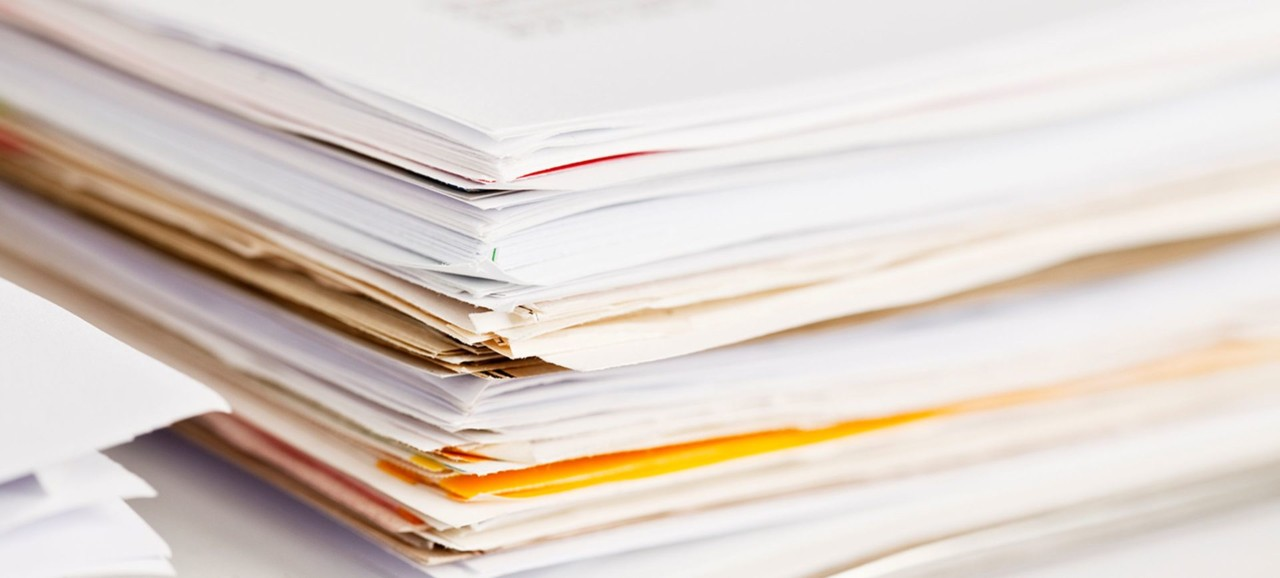 An up-close stack of documents.